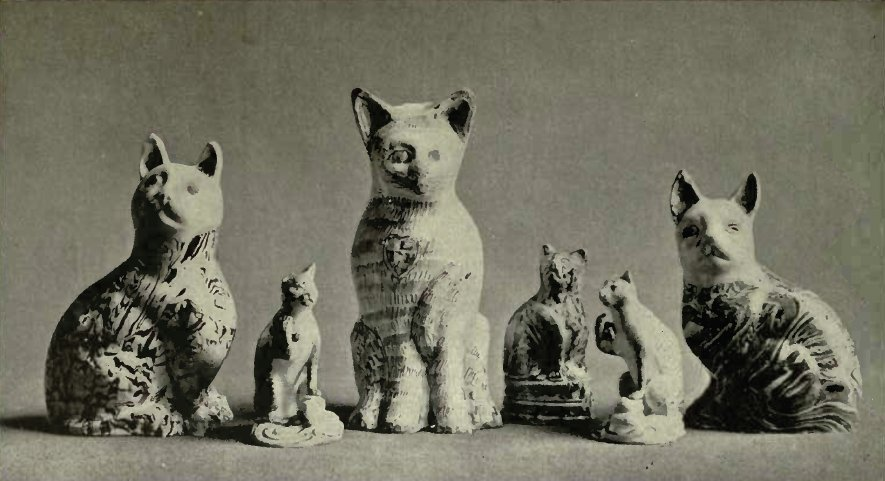 A GROUP OF CATS IN POTTERY